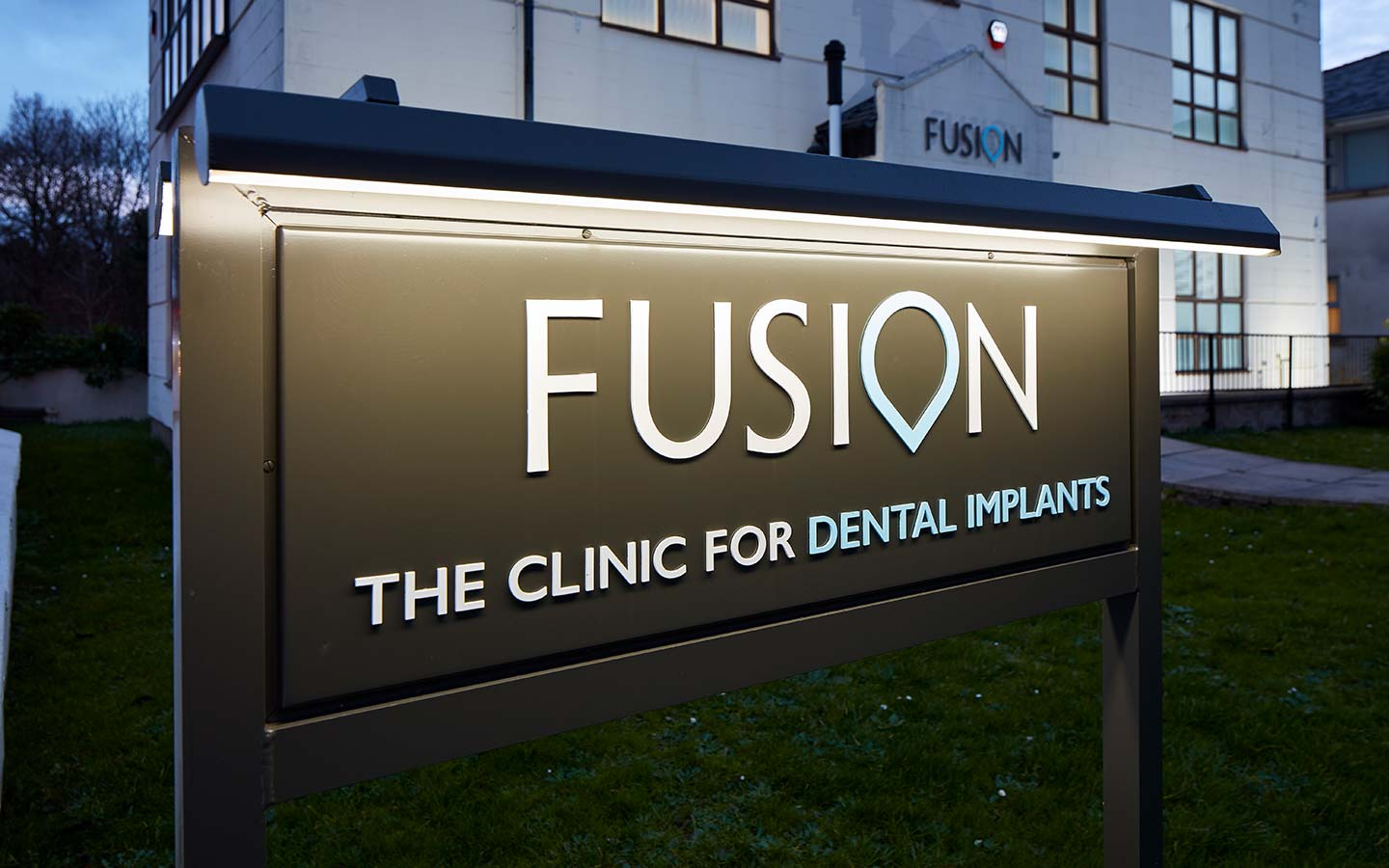 Fusion sign lit up at night