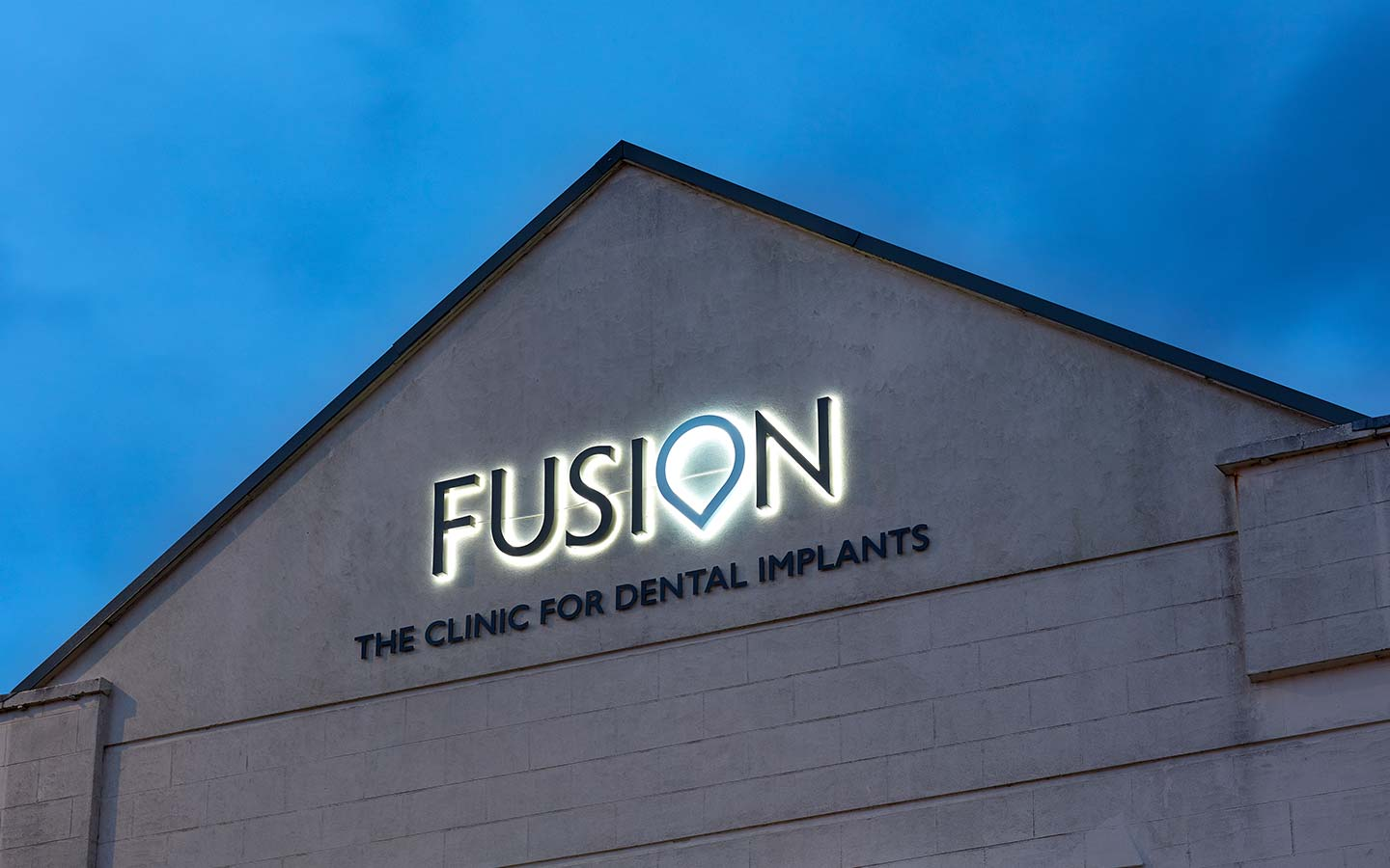 Fusion Dentistry sign on side of building