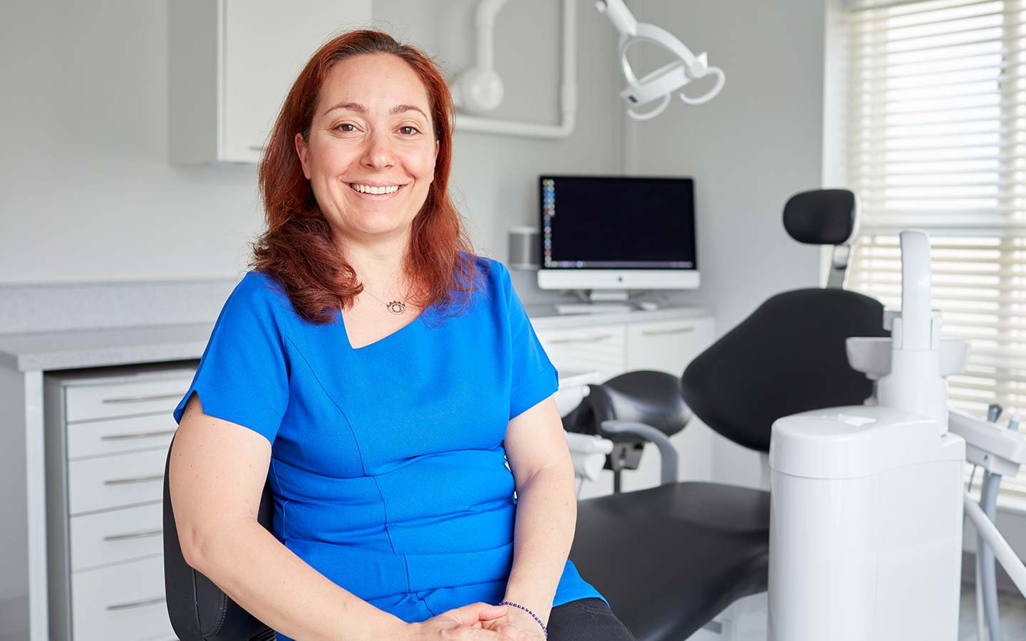 Smiling woman in dental clinic