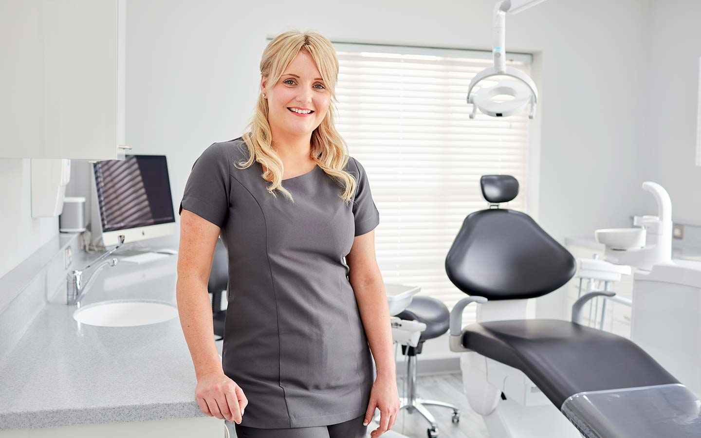 Smiling female staff member at Fusion Dentistry